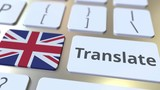 TRANSLATE text and flag of Great Britain on the buttons on the computer keyboard. Conceptual 3D animation - 250195177