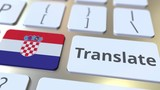 TRANSLATE text and flag of Croatia on the buttons on the computer keyboard. Conceptual 3D animation