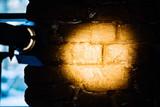 dark red brick wall with spotlight, background photo texture