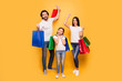 Leinwanddruck Bild - Full length body size view portrait of nice attractive trendy cheerful people holding in hands bags with new clothes having fun rejoice isolated over shine vivid pastel yellow background
