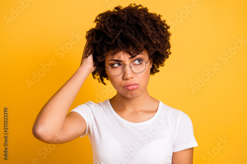 Leinwandbild Motiv Portrait of her she nice cute attractive beautiful confused wavy-haired lady eyeglasses eyewear touching head don't know what to do isolated over bright vivid shine background