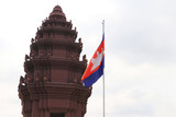 Cambodia flag and Independence Monument in Phnom Penh, An Angkor style tower