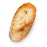 Toasted baguette slice isolated on white background close up.  Toast, crouton.   Top view.