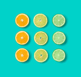 Citrus Fruit pattern on blue background. Orange, Lime, Lemon slices background. Flat lay, top view. .  Pop art design, creative summer concept.. Creative layout.