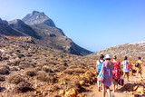 Tourists descend from the mountains to the beach of Balos in Crete, Greece