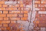 Texture of broken cracked brick wall