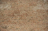 Old brick wall background made of red bricks
