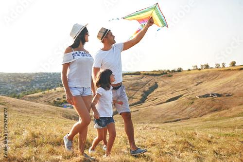 Happy family walking in nature in summer. © Studio Romantic