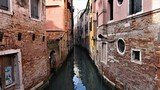 The canal and the district are Venetian old houses in its typical architecture in Venice, Italy.
