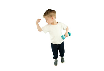 sporty little boy with dumbbells shows his muscles on an isolated blue background. The concept of a healthy lifestyle © Даниил Дудник