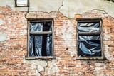 Abandoned brick building with broken windows