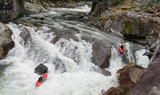 waterfall in mountains and Kayaks