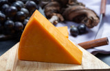 Piece of hard orange Cheddar cheese close up - 250322329