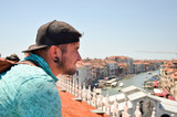 Man looking on Grand canal in Italy, Venice. Tourist man travel looking on roof top