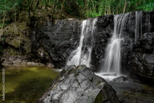 Waterfall in the green forest. Suoi Tranh, Phu Quoc island in Vietnam. Beautiful nature landscape background - 250328135