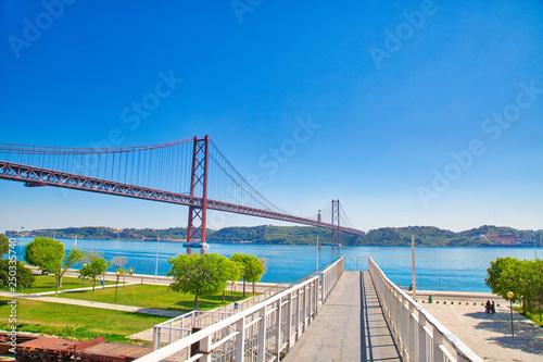 Leinwandbild Motiv Lisbon, Portugal-October 17, 2017: Landmark suspension 25 of April bridge over Tagus River in Lisbon