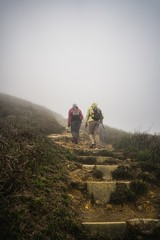 Two Hikers walking up stairs on mountain © Jonathan