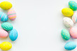 Decorated Easter eggs on white background border space for text