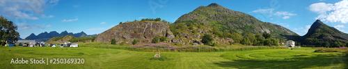 Grassy pasture in the Lofoten island Arsteinen - 250369320
