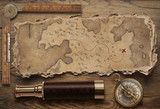 Old torn treasure map with compass and spyglass top view still life. Adventure and travel concept. 3d illustration.