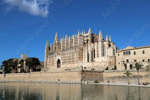 La Seu Cathedral Palma de Mallorca in Spain on a sunny day with blue sky  - 250387514