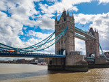 View of Tower Bridge over the River Thames in London, UK on a sunny day.
