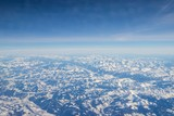 Aerial view of snow covered mountains - snowy mountain peaks - high mountains - Alps