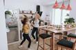 Leinwandbild Motiv Cheerful mother and daughter having fun at home