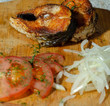 fried fish steak on a board with tomatoes - 250410564