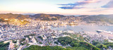 Business concept, modern cityscape of nagasaki dusk from mount inasa, the new top 3 nightview of the world, aerial view, copy space