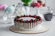 white cake with berries and chocolate