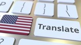 TRANSLATE text and flag of the United States on the buttons on the computer keyboard. Conceptual 3D animation - 250424124