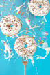 Floating in the air donuts on a blue background. Sweets, pastries.