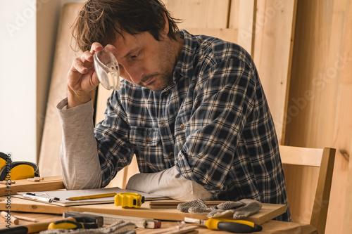 Carpenter planning DIY project in woodwork workshop © Bits and Splits