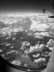 wing of the aircraft and clouds in flight, air whipped clouds, shot in black and white style