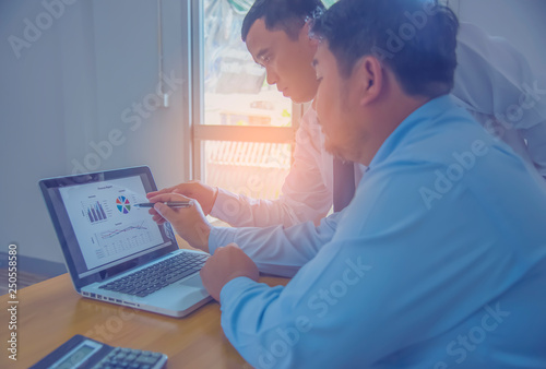 Business team working on a new business plan with modern digital computer