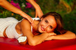 Leinwanddruck Bild - Ayurvedic relaxing massage ,health beauty happy closed eyes woman in spa salon getting massage on the holiday beach.Beautiful girl enjoying day spa resort, lying down on the table treatment procedure