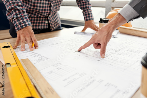 Architect showing mistake in construction plan