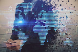 Double exposure of World map polygonal with man using phone. Globalization concept.