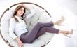 Leinwandbild Motiv tired young woman resting in a soft round chair