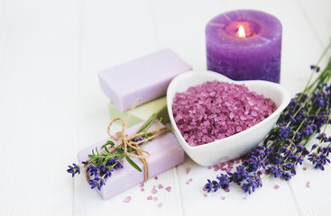 Heart-shaped bowl with sea salt, soap and fresh lavender flowers © almaje