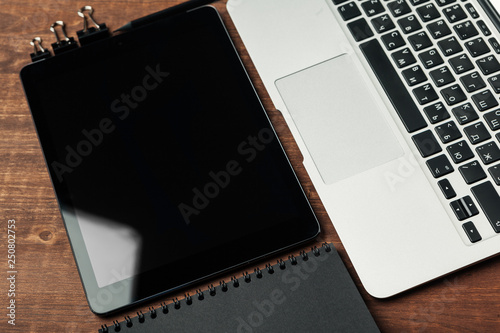 electronic gadgets and office supplies on wooden table