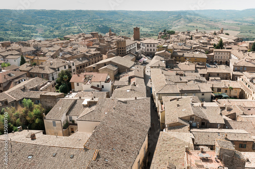 Orvieto. Overlooking small Italian city with rooftops and Umbrian fields on the background.