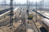 Complicated railway network with power lines and freight wagon for track maintanance, sunny day, Smichov, Prague, Czech Republic