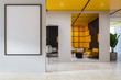 Black and yellow office waiting room with poster