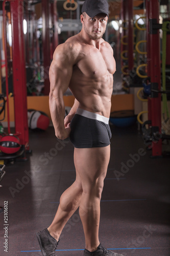 a man is engaged in bodybuilding in the gym, raises the bar and trains his muscles.