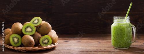 glass jar of kiwi juice or smoothie with fresh fruits - 251016545