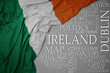 waving colorful national flag of ireland on a gray background with important words about country - 251030720