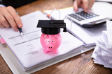 Pink Piggybank With Graduation Hat On Folder