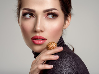 Beautiful young fashion woman with living coral lipstick. Attractive white girl wears luxury jewelry.